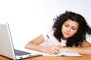 Photo of girl researching, deciding if she should go to a 2 year or 4 year college